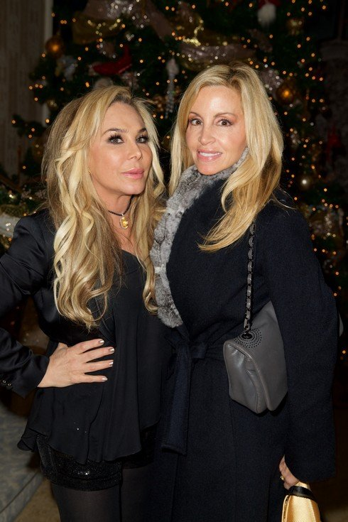 BEVERLY HILLS, CA - DECEMBER 24: (L-R) Television personalities Adrienne Maloof and Camille Grammer attend Adrienne Maloof's Annual Holiday Party with Never Too Hungover on December 24, 2016 in Beverly Hills, California. (Photo by Earl Gibson III/Getty Images)